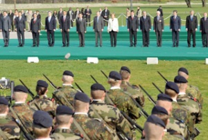 The heads of NATO member-states paying tribute to NATO military personnel during the alliance's 60th anniversary summit