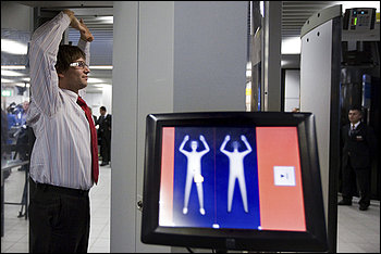 An employee of the Netherlands' Schiphol Airport demonstrates the use of a whole-body scanner at a news briefing on Monday. (Cynthia Boll/associated Press)